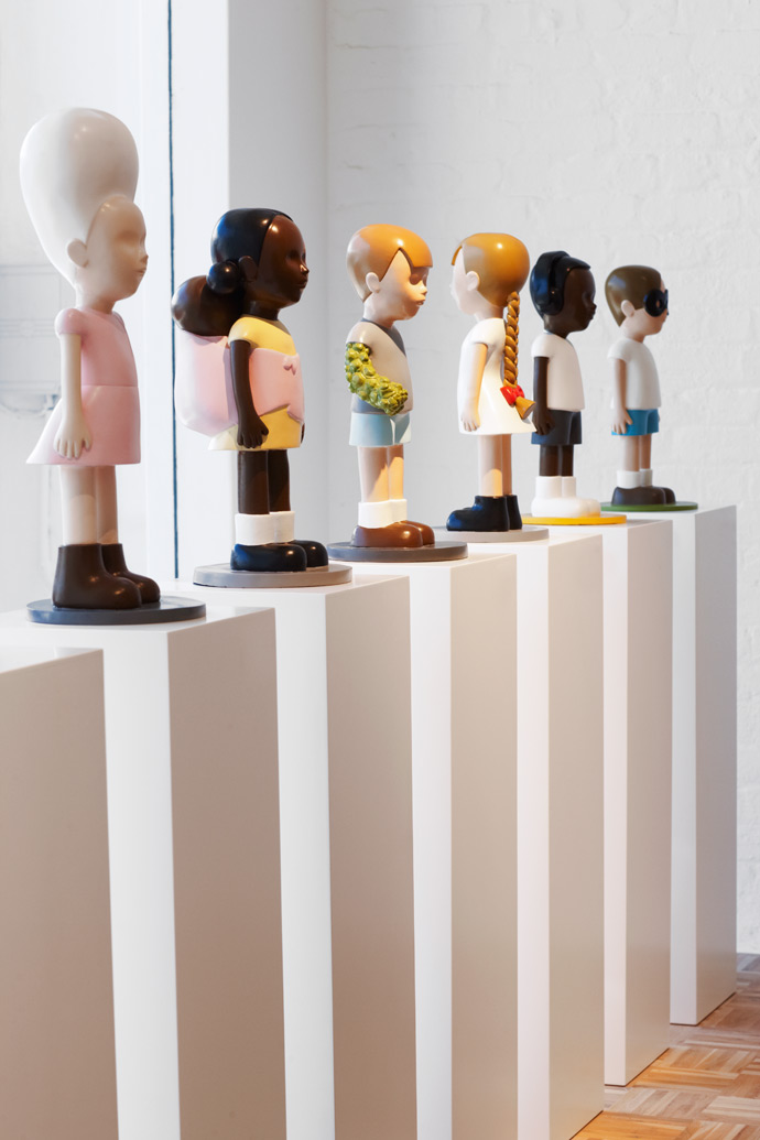 Justine Mahoney's Beehive, Girl with Baby, Monster Boy, Puberty, Boy with Headphones and Masked Boy, crafted in bronze and enamel paint.