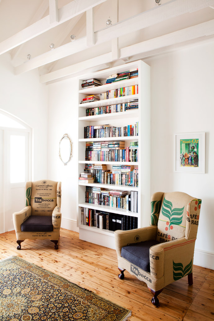 Cara had two old wingback chairs, a gift from the previous owners, reupholstered in coffee bean bags she had rescued from The Old Biscuit Mill coffee shop. The bookcase is custom-made and the Persian carpet is from anantique shop in Kloof Street.
