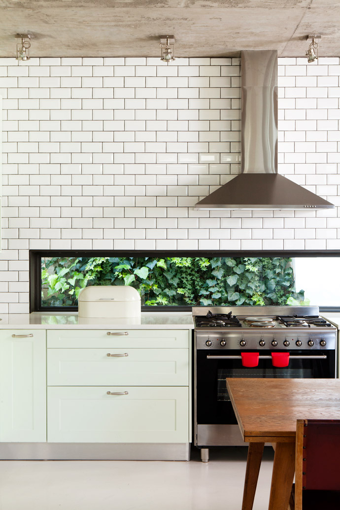 Cara designed the kitchen herself and had the bespoke cupboards painted in Plascon's Mint Whisper, her favourite colour. A cleverly placed window lets in light and nature. The subway tiles are from The Tile House.