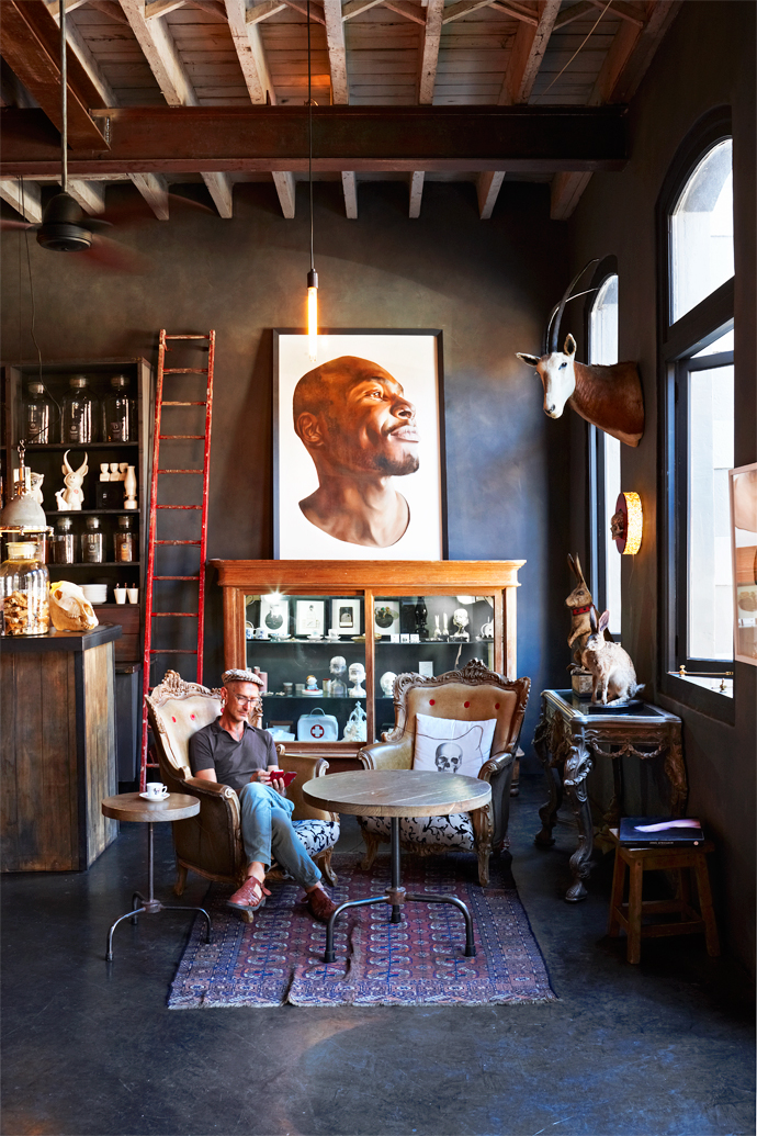 """A predominantly grey palette was used to create a moodily dark and comforting atmosphere. The artwork on the wall behind Mark Rautenbach is titled Limina 5; it's part of aseries of five paintings by Vanessa Berlein called """"Disengagement""""."""
