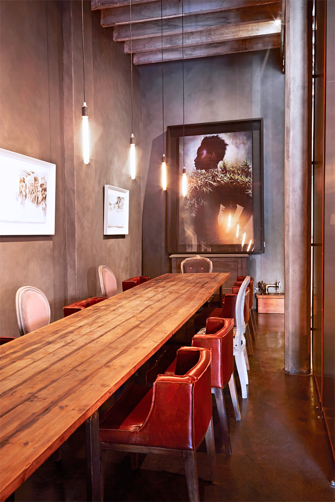 The boardroom is one of Francois's favourite spaces at Haas. An 18-seater table made of reclaimed wood and salvaged metal beams fills the space, which can be hidden from view by a screen drawn closed. The photograph on the far wall is by Krisjan Rossouw.