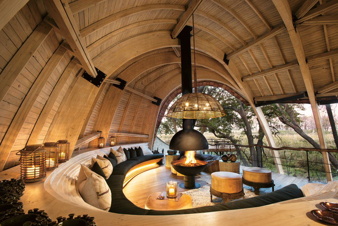 With architecture the hero at Sandibe Okavango Safari Lodge, the decor is understated and organically inspired, with just a few accent pieces to make a design statement. There's an absence of colour, except for the warmth of wood and the glow of copper.