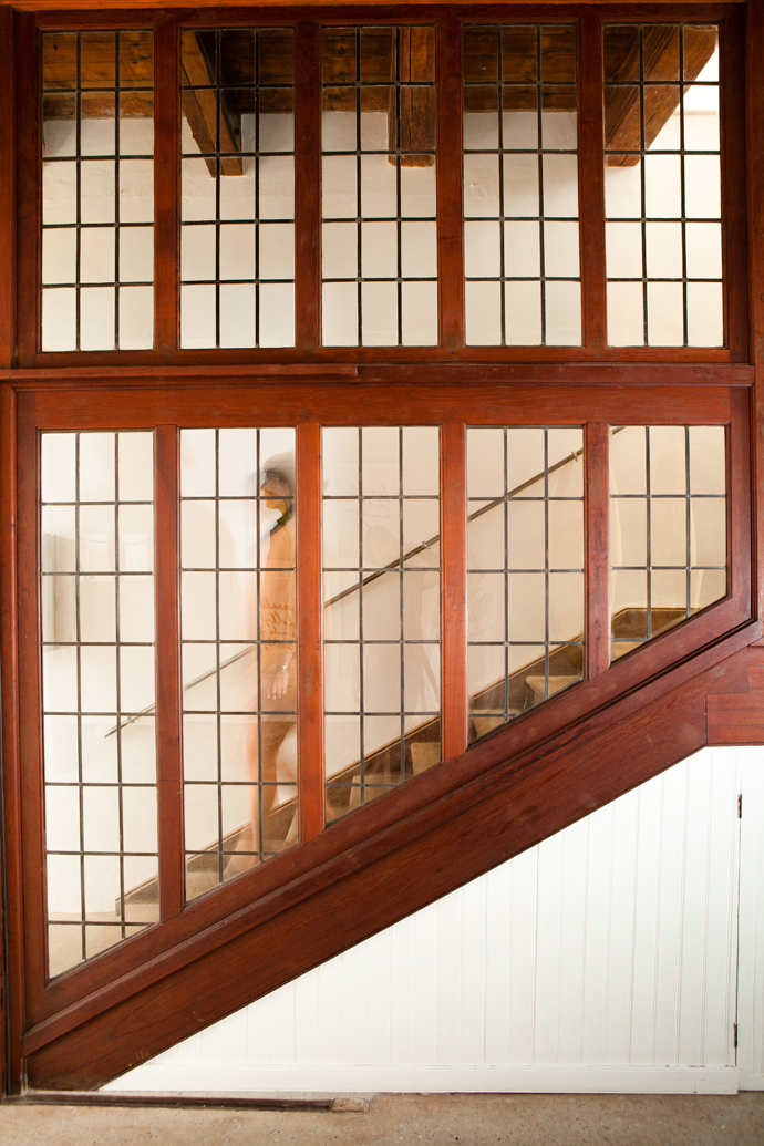 Leading to the upstairs offices is this fully restored teak staircase – a couple of its leaded glass windows and panes the only modern replacements.