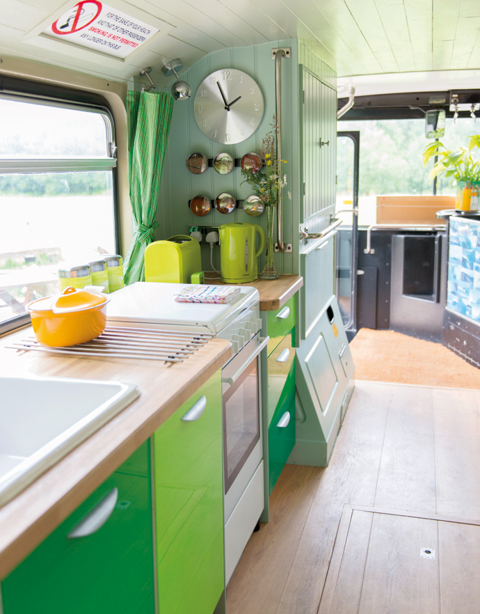 "Adam chose to cover the doors with a vivid green Perspex and add a solid oak worktop. ""It was the cheapest kitchen I could get. I like the fact I made something look rich that wasn't. The mix-and-match philosophy worked well, and it's like wearing a pair of designer jeans with a shirt from a supermarket."""