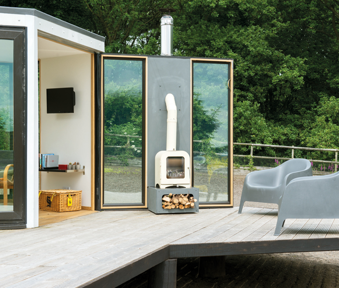 Barry has designed this pod to have one entire wall that is hinged and opens out onto a deck. The neat, simple and contemporary wood-burning stove swings outside, too, creating an eye-catching indoor/outdoor space. How about that!