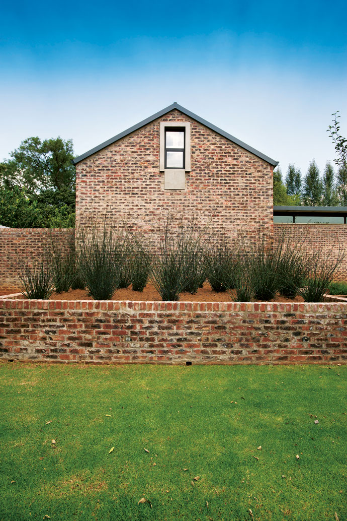 This home was created for informal living and low maintenance. The wash-and-wipe technique used on the brick walls complements the farm-like estate setting.