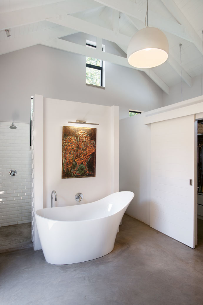 The stylish en-suite main bathroom is fitted with white metro tiles and Hansgrohe tapware, which has a 15-year on-site guarantee. Hot water is supplied by aSEG Solar Energy water-heating system.