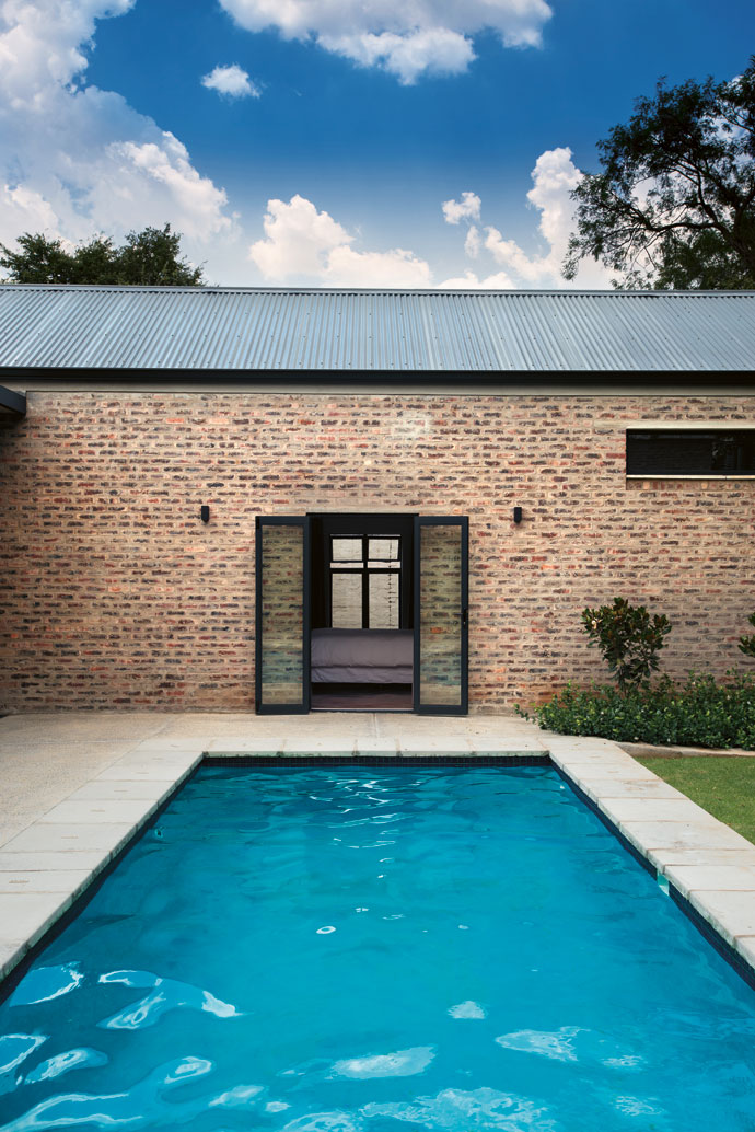 The courtyard swimming pool allows the Bothas to keep awatchful eye over theboys  while they swim, and on hot days it acts as apassive cooling device asthe cooled breeze off the water blows into the house.