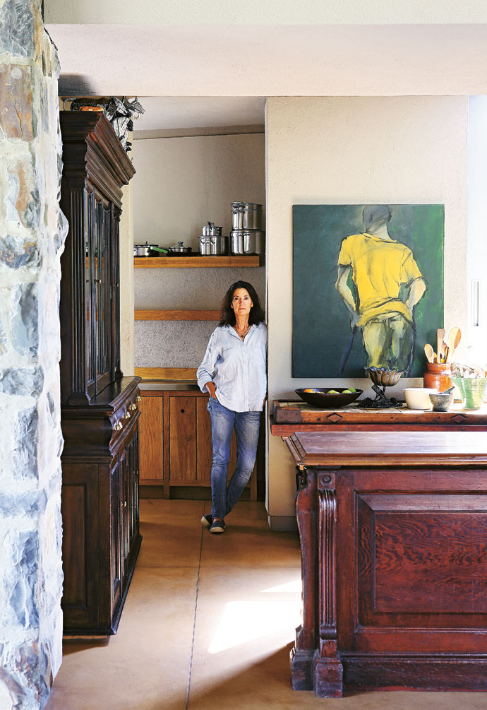 "René in her kitchen. ""I do not like kitchen units,"" she says, and I do not like the idea of designing a kitchen around my utensils. I find beautiful furniture and then fit my stuff into it."""