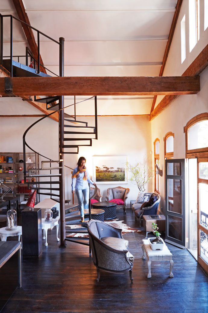 Francois Irvine bought most of the French armchairs in Egypt. The Haas team then reupholstered them in reclaimed fabrics and leather. Nuha Abrahams makes her way down the spiral staircase.