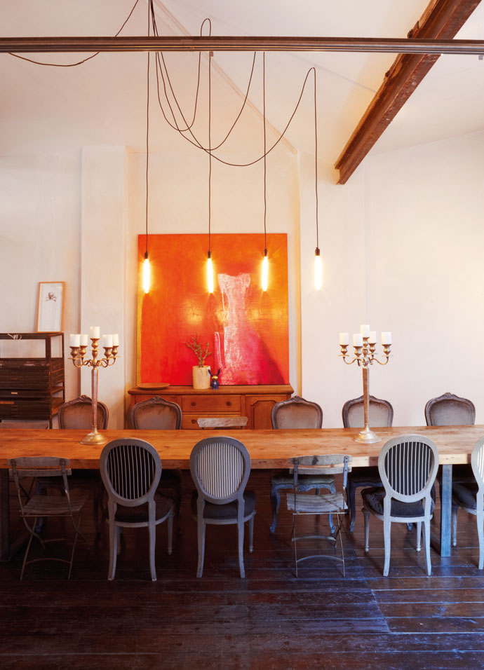The boardroom table was designed and made by the Haas team. The painting is by Francois Irvine.