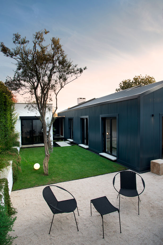 Originally, the garden couldn't be accessed without going around the side of the house, so Nico incorporated a courtyard-like garden that can be entered from the bedrooms and study. The outdoor furniture is from Big Blue in Kalk Bay.