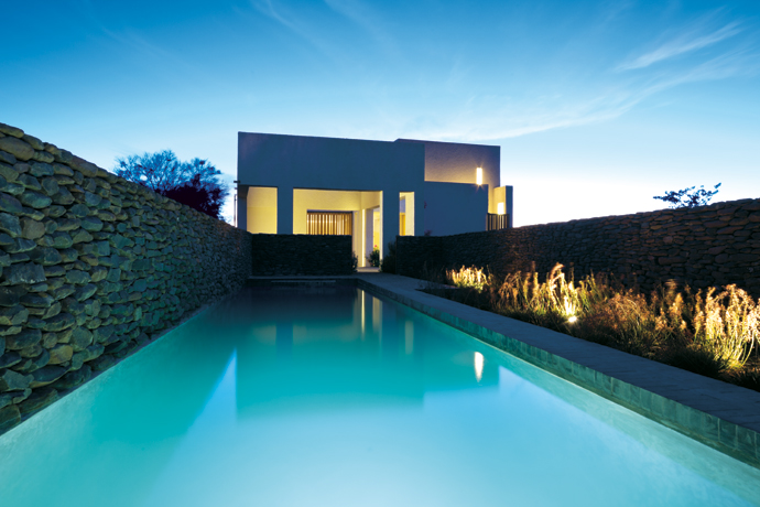 """The pool was built by the project contractor, Hendrik de Villiers, """"who is amazing,"""" says Jennifer. Thestone for the cladding came from anearby farm; Jennifer chose it to match the colours of the mountains."""