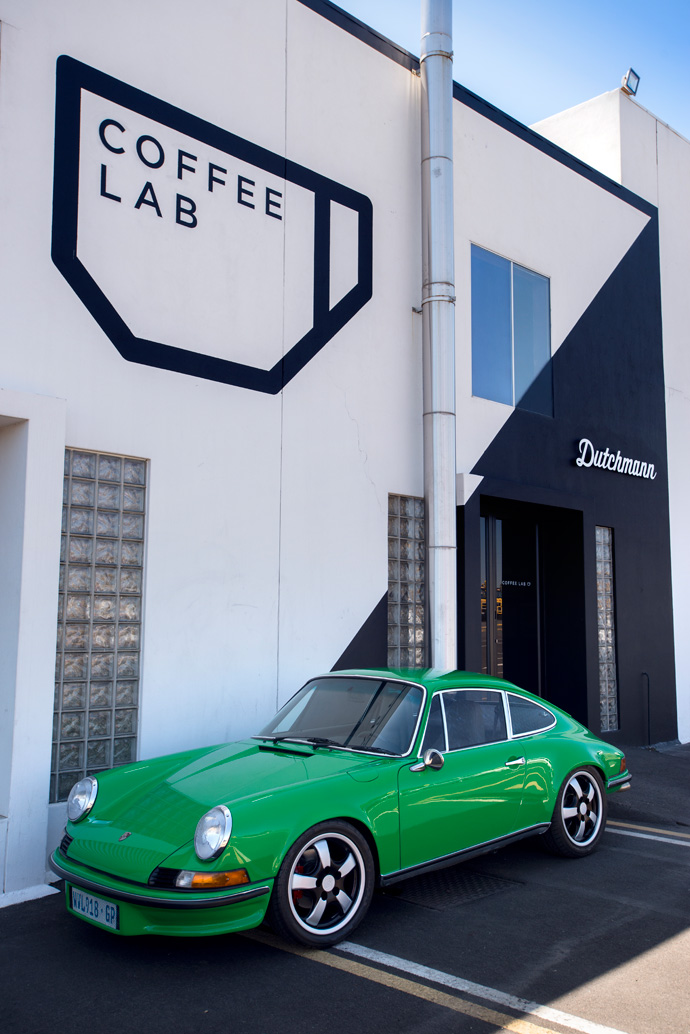 A 1970 Porsche911 in front of the showroom, which houses both Coffee Lab and the Dutchmann workspace and showroom.