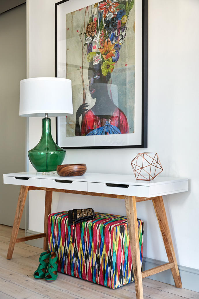 The print in the entrance is by Polish artist Olaf Hajek, from his exhibition at WHATIFTHEWORLD gallery. The colours are picked up in anottoman that is covered in Hertex fabric and a Bardot table lamp from Block & Chisel.