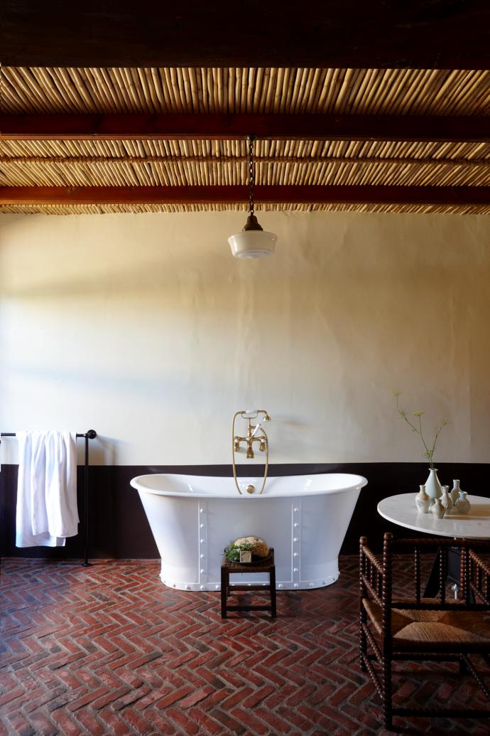 "The generously proportioned guest bathroom is almost the same size as the guest bedroom. This wasn't always the case. Originally, the house had six bedrooms and six bathrooms. Says Jacques, ""We decided to simplify it into a two-bedroomed, two-bathroomed house. We reimagined the rooms; we wanted less to become more."""