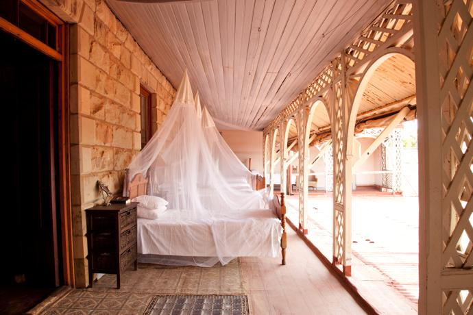 What better place to sleep on a hot summer's night than on a comfortable bed under a mosquito net on the porch?