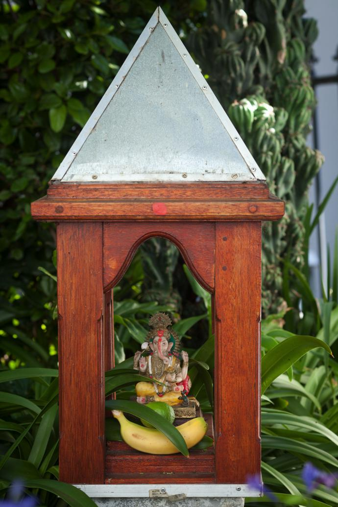One of Wim's many rituals is a fruit offering tothe gods in the garden temple.