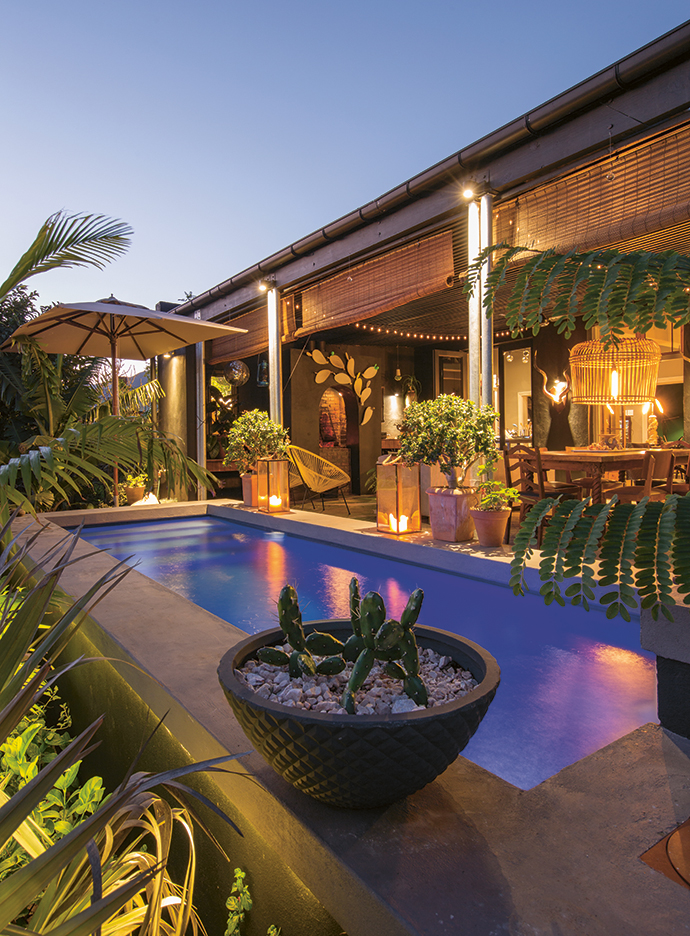 The blue-lit swimming pool is both functional and decorative. Robertson gets extremely hot in summer and a swimming pool is essential, says Etienne. There is a tropical feel to the stoep; Etienne's love of all things nature is evident.