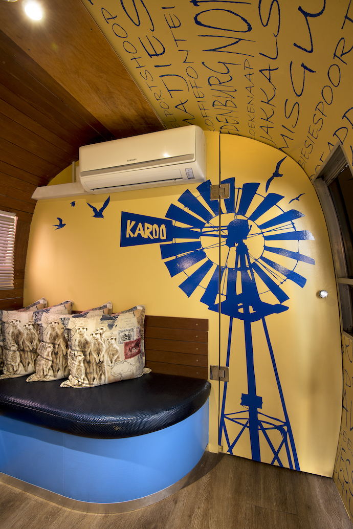 Who said you can't go country in the city? The interior of the delightfully bright Karoo Dorps trailer.