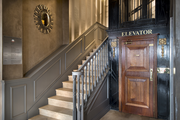 Take your pick going up to the lovely rooms: either the grand staircase past the mirror from Hadeda, or Cape Town's oldest working elevator.