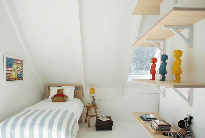 Fun and games happen in the attic, where the kids' bedroom features single raw pine beds designed and made by Philip Montsho. The side table is from Weylandts and the lamp from @home.