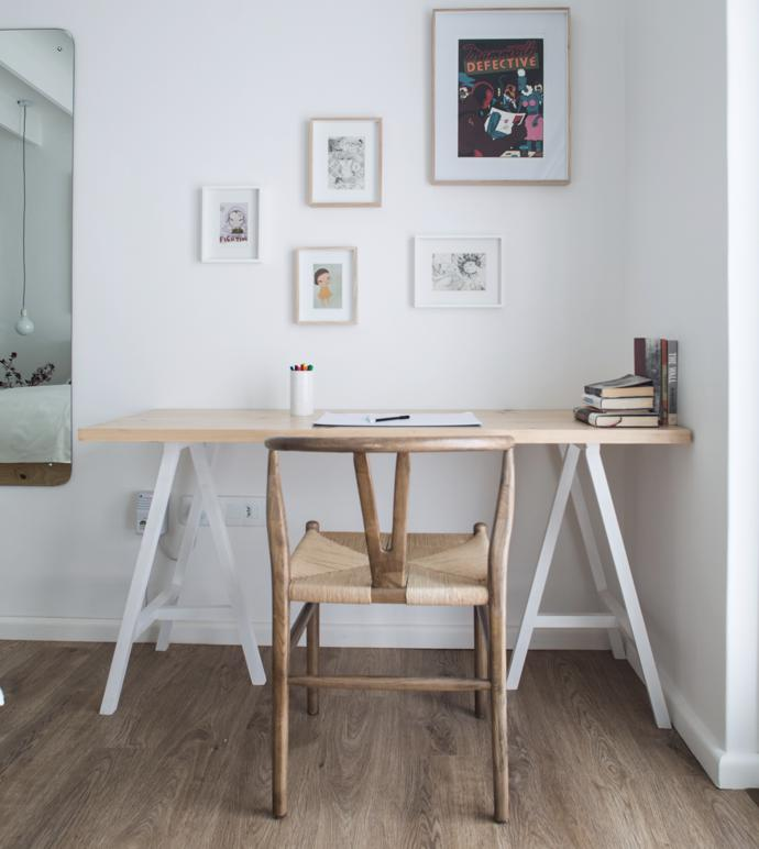 The informal desk space in the main bedroom features a custom-designed trestle table with awishbone chair in neutral shades. The oak-feel vinylfloor is both practical and warming.