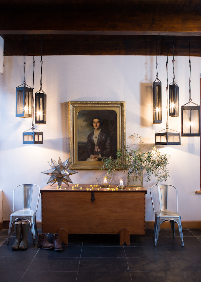 A portrait of the wife of a Portuguese ship's captain – his granddaughter inherited it and bequeathed it to Wouter's stepfather Andrew – is lit by striking metal pendant lamps designed by Illze and welded by her friend Hannes Oosthuizen. The two chairs are from Builders@home.