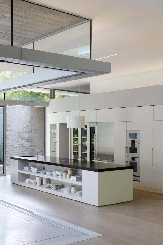 The kitchen is kept simple with a plain long counter. This, says Mandi, is a great gathering space. With the sliding doors fully open, the kitchen feels like a part of the outdoor courtyard space.