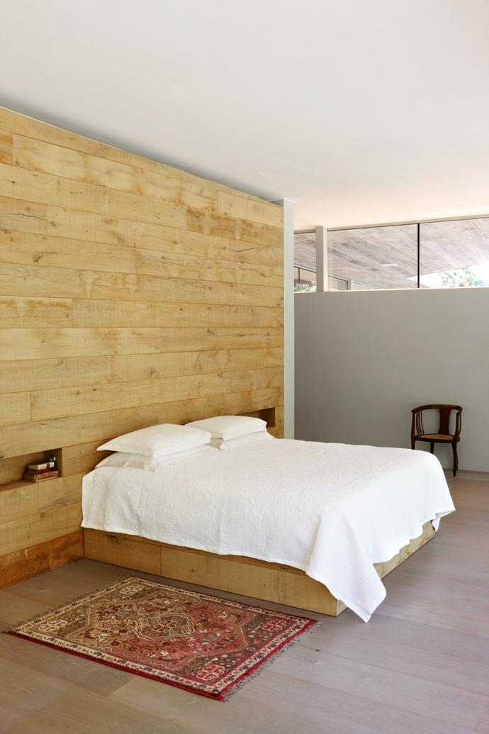 A custom-made integrated timber unit serves as headboard and backdrop to the main suite.