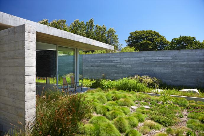 The landscape creeps right up to the house, creating an almost seamless integration between building and nature.