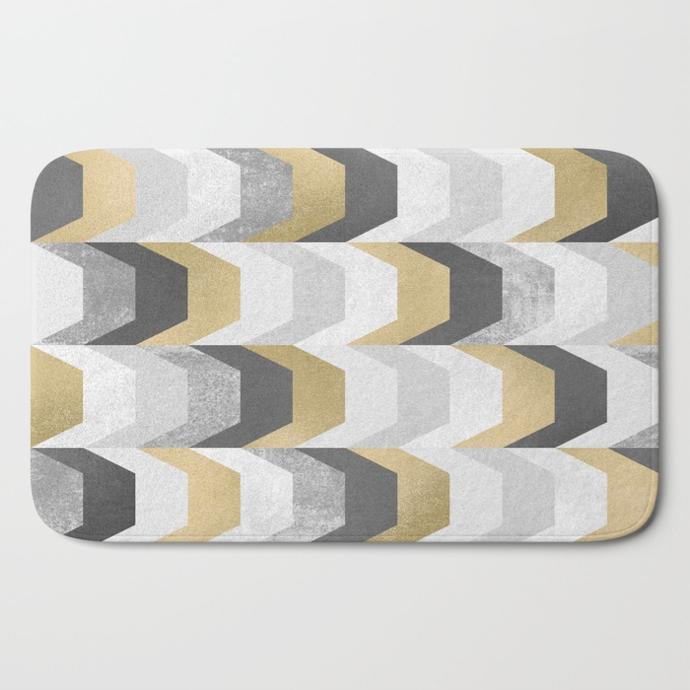 stacks-of-gold-and-grey-bath-mats