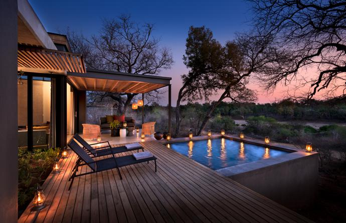 As day turns into night in the Bushveld, the private deck of your villa is the best place to be. The pool loungers are from Macalli and the Malawi chairs from Amatuli.
