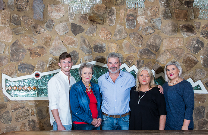 Chas and Cathy Prettejohn, husband and- wife owners of Ngwenya Glass, with their family: their son James, Chas's mother Alix and daughter Lara-Gwynne.