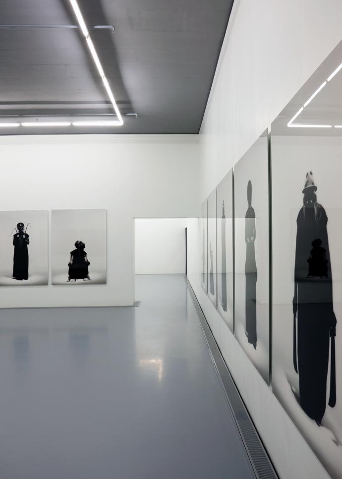South African artist Mohau Modisakeng's large-scale photographic prints line the walls of one of the galleries.