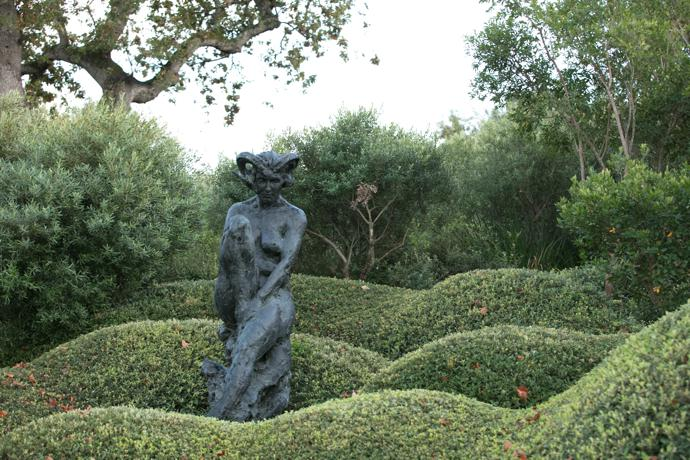 """A female form, Trans-Figure XXII, among undulating, meticulously pruned shrubs. """"The paradox of the garden does not escape me: that for someone who dearly loves the wilderness I have attempted to control, contract, constrain."""""""