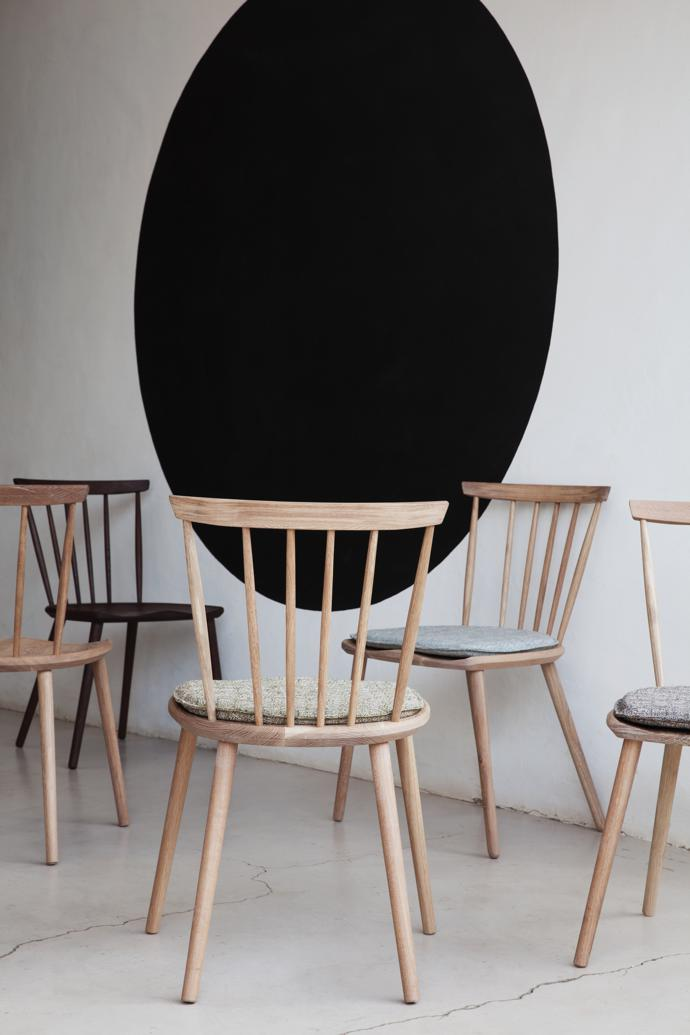 Spindle-back dining chairs in oak, R2 200 each.