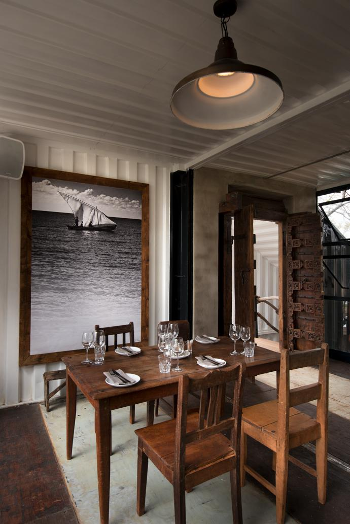 The David Ballam print of a dhow in the upstairs bar is from his Ilha de Mozambique series. The wooden table and chairs are from Cameroon.