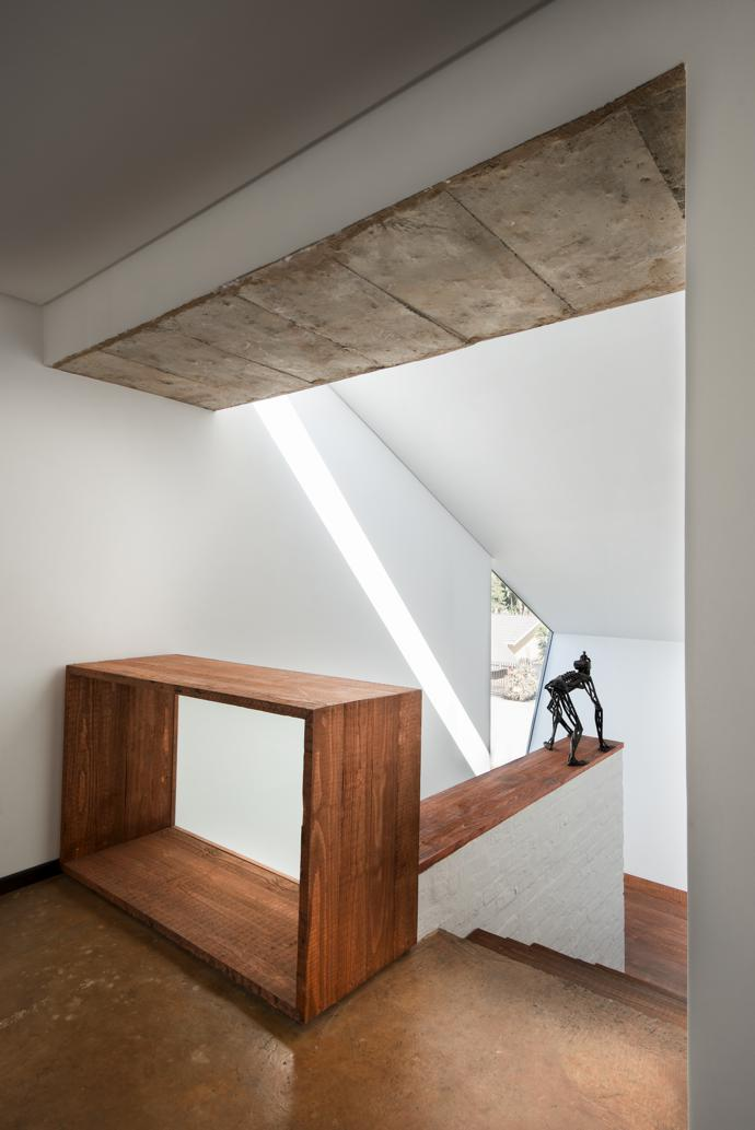 """""""We intended the staircase to be an orientation device as well as a landmark,"""" says Pieter. A sculpture by Sybrand Wiechers, titled Homunculus, keeps watch over the landing."""