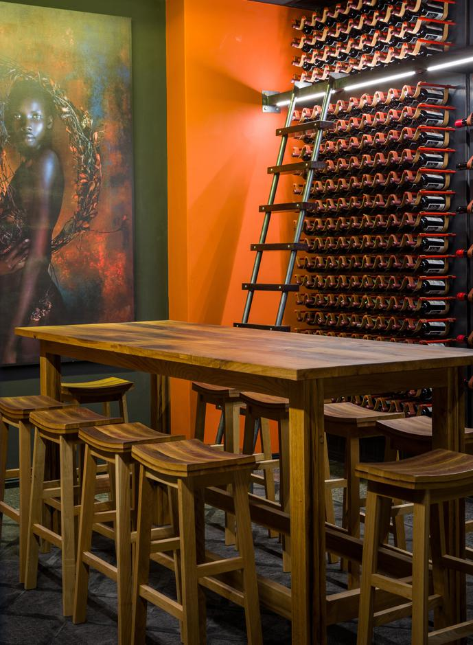 """The cellar, with its horizontal leather strap storage system, is dominated by a large Krisjan Rossouw photograph, titled Patricia II. """"The winemaker is a woman, and so is the co-owner,"""" says Haldane, """"so we wanted to include a strong feminine element that honours the female entrepreneurs behind the project."""""""