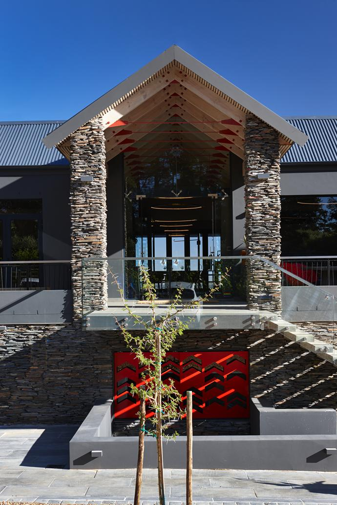 Grey Table Mountain slate cladding adds texture and aesthetic appeal to the main entrance.