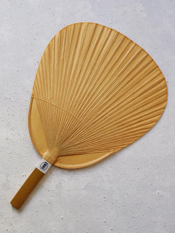 Shibu Uchiwa fan by Kutami, R600. Kutami is a town in Kumamoto Prefecture famous for its Japanese fans. The fan is made from paper and coated with persimmon tanning for durability and to repel insects. It is used to fan coals or cool rice.