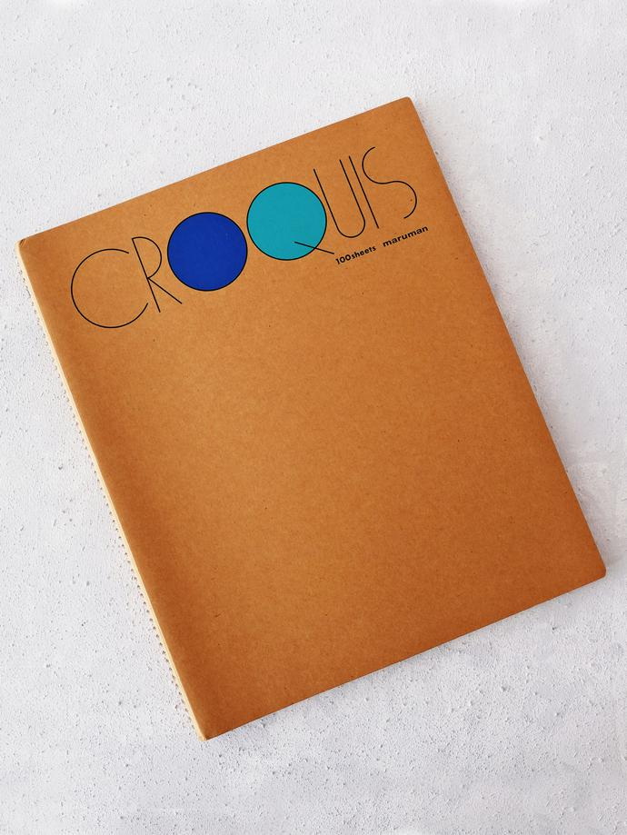 Croquis Sketchbook (Medium) by Maruman, R230. Medium Croquis range sketchbook by Maruman, a paper company established in 1920. The book includes 100 sheets of 52.3g/㎡ Maruman original white croquis paper with a cover made of durable kraft paper and wire spiral binding.