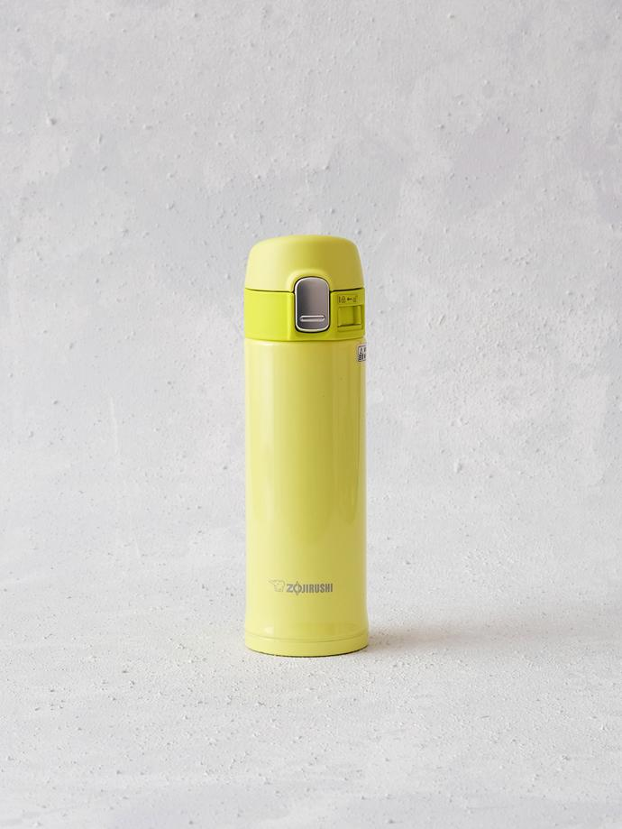 300ml Stainless Vacuum Flask (Lime Yellow) by Zojirushi, R450. 300 ml stainless steel vacuum flask for hot or cold beverages, with one hand touch open and lock mechanism. It has a 3 cm wide mouth for easy drinking. It maintains hot liquids at 85°C for one hour and at 69°C for up to six hours, and cold liquids at 9°C for up to six hours. Zojirushi was established in 1918 and is known as Japan's famous
