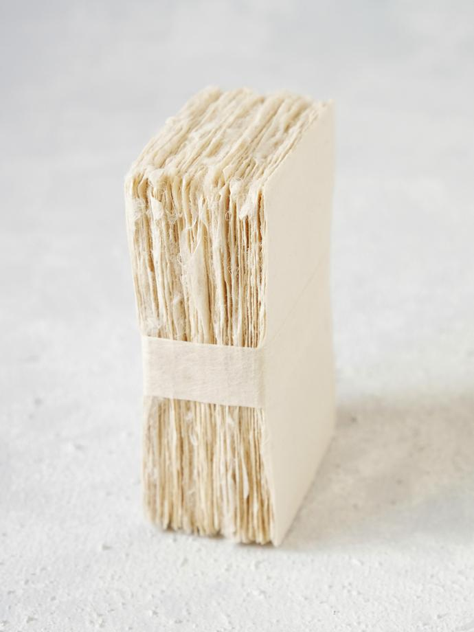 Hand-torn blank washi business cards (pack of 50) by WACCA, R850. Made from paper pulp and bark to add rigidity. Made in the Ogawa region and the intent is to apply your own logo or design.