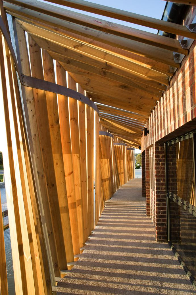 The light falling through the slats onto the walkway changes throughout the day. It is Tessa and Dax's favourite element of the mill, and the one that architect and artist Andrea Cristoforetti is most proud of.