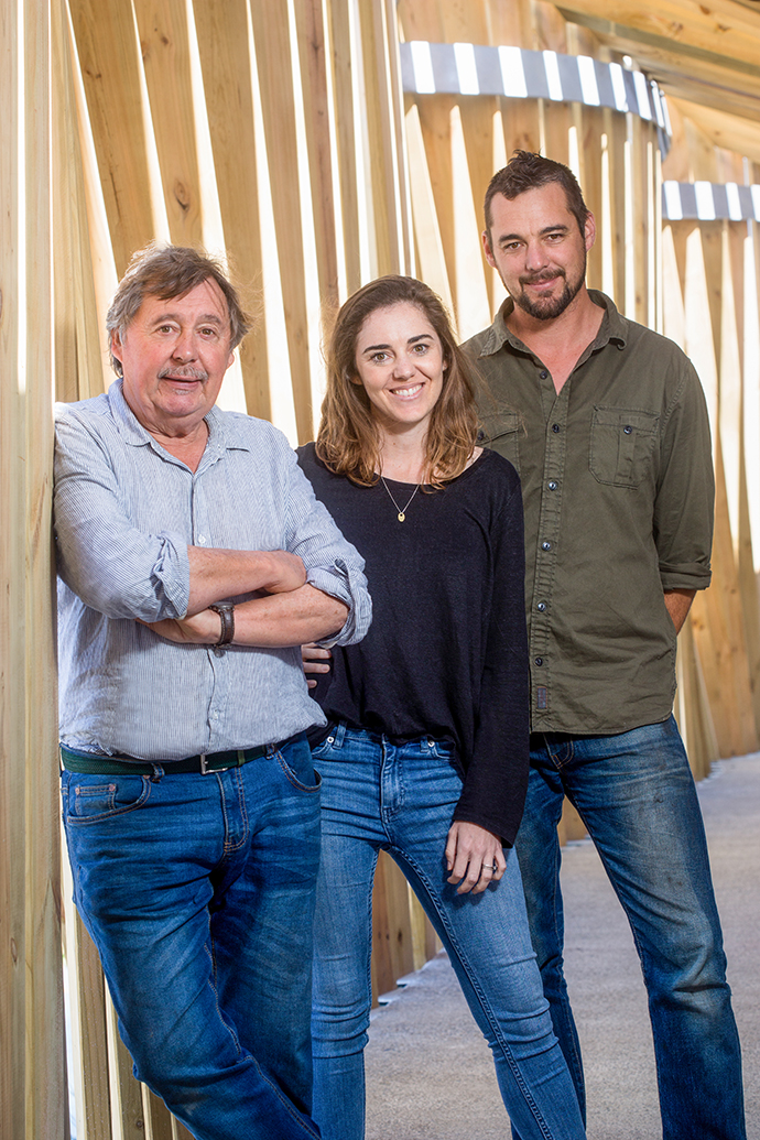 Mungo founder and master weaver Stuart Holding with his daughter Tessa, who oversees Mungo's marketing and creative direction and the Cape Town store, and son Dax, who manages operations in Plett and spearheaded the development of the new mill.