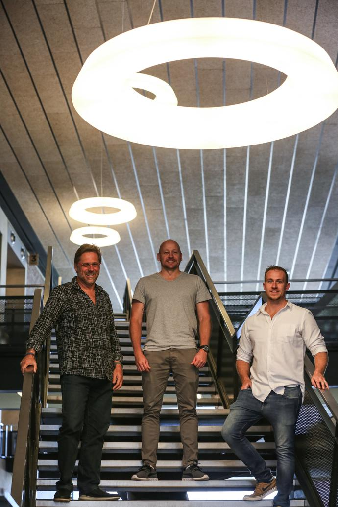 The project team – architect George Elphick, interior designer Mike Long of Novospace and architect Pim Artz – on the cascading central staircase.