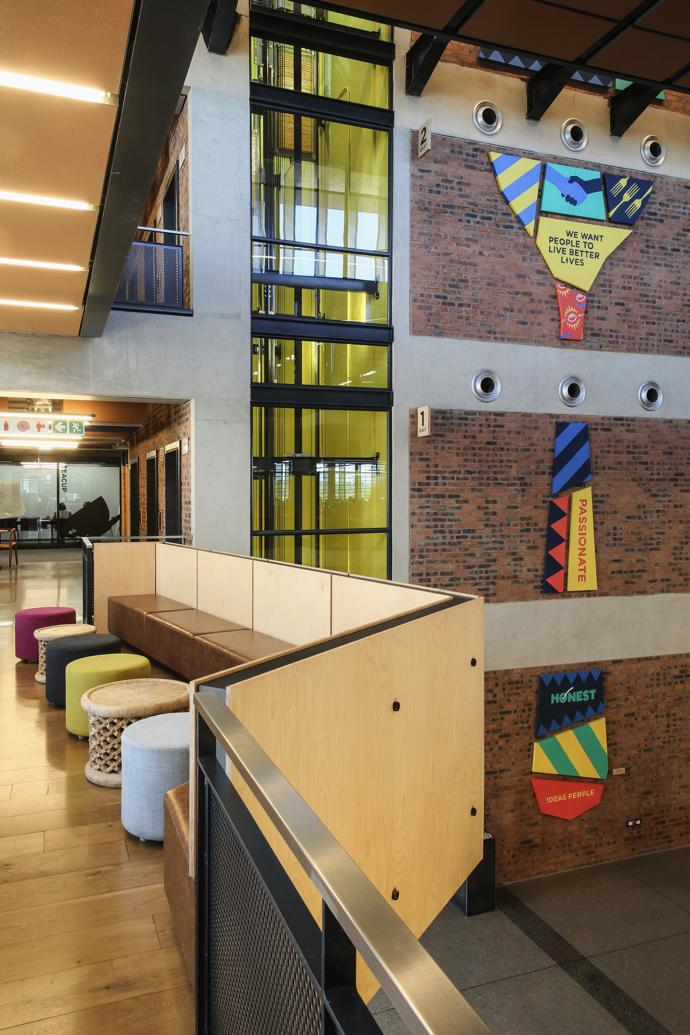 Face-brick and birch ply cladding are used throughout the interior. The giant artwork is by The Hardy Boys.
