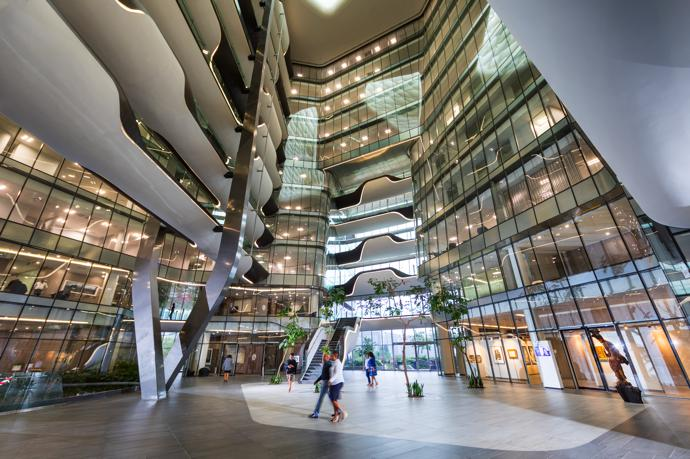 The north atrium includes the sculptural support for a bank of bridges. The gallery, which houses much of Sasol's impressive art collection, is to the right.